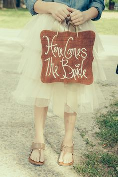 Not sure what I love more, the signage or the fun tulle skirt behind it!  #brideside #realwedding #wedding #signage #skirt #tulle #fun #details   A laid back and simple farm wedding rich in detail and color | Brideside