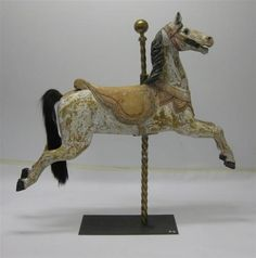 A carved wood and polychrome decorated carousel horse early 20th century. Height 153 cm