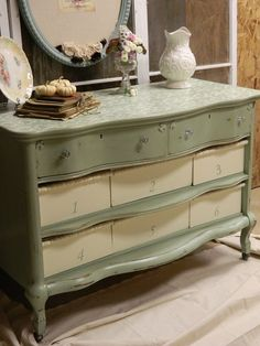 an old dresser with missing drawers + a few wood boxes + old spindles cut for handles + paint = a versatile piece of furniture - what a great dump rescue!!