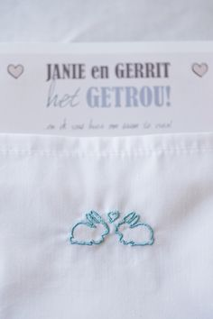 cute embroidered bunnies on wedding napkins