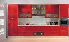 red kitchen, stainless steel appliances, pale floor