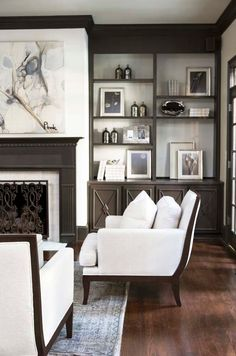 Brown painted built in shelves and fireplace mantel.  White background and walls.