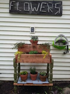 Flowers sign from old barnwood and sticks