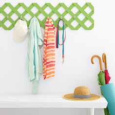 Keep outdoor gear handy with this colorful and practical string of coat hooks attached to a lattice wall rack.