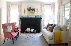 Bryn Alexandra Interiors. Nice cheery living room with painted brick fireplace.