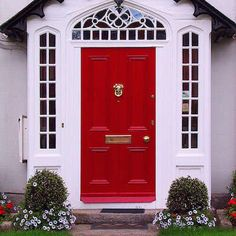 Classic Red This raised panel door, framed by glazed side lights and a decorative transom, has classic charm and gobs of curb appeal. The black trim over the transom adds contrast and visual pop.