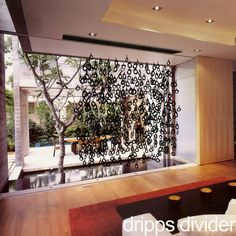 Inspiration: a collection of any shape in acrylic can be suspended from a ceiling plate to act as a screen | www.peregrineplastics.com