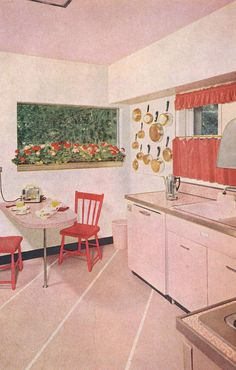 Such a charmingly pretty pink vintage kitchen with cafe curtains. #pink #1950s #vintage #retro #kitchen #home #decor