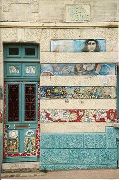 Turquoise door. Decorative wall. France