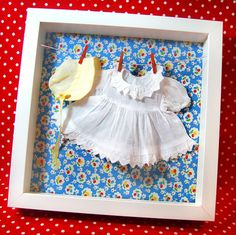 such a cute way to display doll dresses