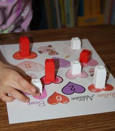 A Learning Journey: Unifix Cube Valentine Addition Bump Game