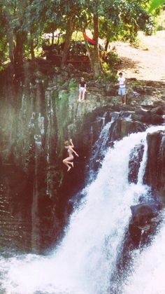 cliff jumping in hawaii...have to go I have Jumped there Kauai, there is a rope swing to the right about 45-50 ft drop if you swing right.. Great PLACE !