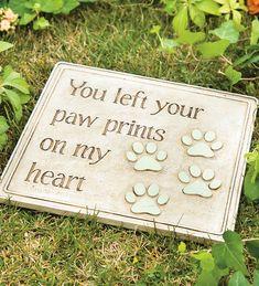 Pet Paw Prints Garden Stone -   http://thegardeningcook.com/paw-prints-garden-stone/