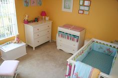 A bright and sunny baby girl's nursery