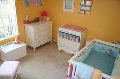 A bright and sunny baby girl's nursery