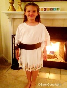 Homemade girls Natchez Indian costume- white t-shirt with cut fringe & wooden beads