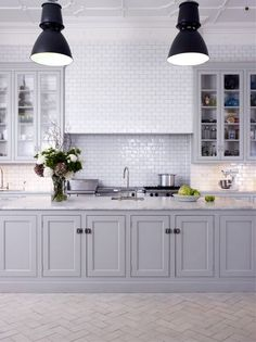 grey cabinets, white walls, ceiling detail and light fittings