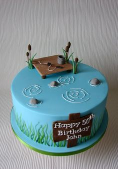 Can be a shower cake with bride on dock hooking groom in water. Make dock higher so bride can dangle her feet.