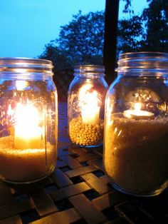 outdoor lighting: mason jar love. While camping we used to fill brown paper bags with sand then light a tealight candle in centre. Beautiful light. Tissue paper lanterns (paper with patterns cut into them and taped around a pyramid made of sticks) are also a fun activity!