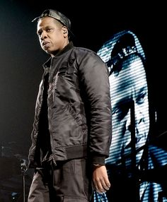 Watch the throne. Nine-time 56th GRAMMY Awards nominee Jay Z rules the stage during a performance on Dec. 9 in Los Angeles