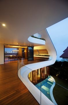 Yacht House Design in Singapore  Situated on top of Siglap Hill in Singapore with magnificent city view,  this unique house resembles a yacht. Designed by Aamer Architects, the  bedrooms on the ground level are connected to the swimming pool. The  living and dinning areas on the second level are connected with the  outdoor verandahs. The house has a lovely resort style feel with elegant  simplicity.