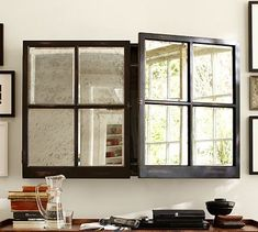 "Mirror Cabinet Media Solution #potterybarn $449. 50"" wide x 6"" deep x 32"" high  Covers up to a 46"" diagonal–screen TV.  Made of mango wood with a distressed black painted finish. Panels open for viewing TV. Antiqued mirror glass. Mounts to the wall."