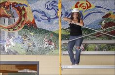 PHOTO GALLERY    Local artist Gail Christofferson-Works shows off a recently finished mural at the new Otsego Elementary School.    She coordinated the work of students, teachers, and staff on the Mosaics by Knights mural.
