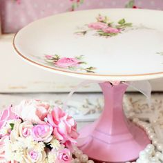 Glue a pretty plate to a candlestick holder...