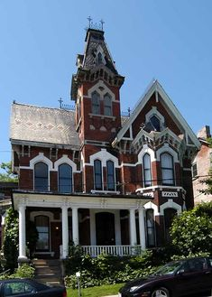 Brockville is absolutely dripping with fabulous Victorian Villas. This one has Gothic Revival accents such as the trefoils and high ointed gables. It also has roundels, cornices and a Queen Anne style veranda.