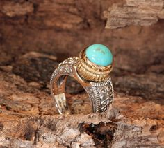 Silver and Turquiose Ring, This would be perfect if it had some diamonds and opal for a mother's ring.