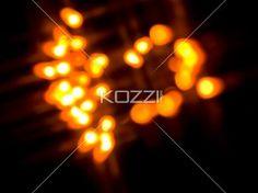 cluster of orange lights. - Defocused image of orange neon lights.