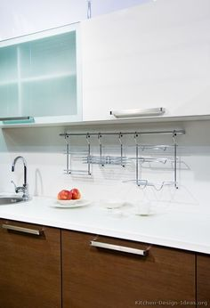 #Kitchen Idea of the Day: Modern Two-Tone Kitchens. Note the backsplash storage rack.