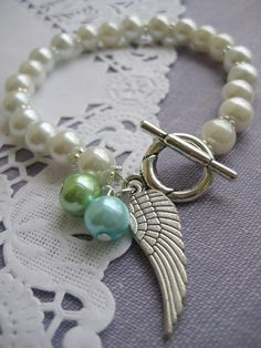 Miscarriage loss angel wing glass pearl bracelet.