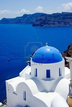 blue dome churches and classic cyclades architecture over the mediterranean sea in oia santorini island,greek  Stock Photo