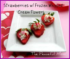 Simple & Healthy Valentine's Treat: Strawberries w/ frozen whipped cream flowers.
