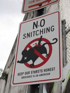 """I'm torn, if I don't snitch and obey this sign I'm un-American... if I snitch and tell the truth I'm making the streets less honest. I'm going to file this one under """"occupy stupid""""."""