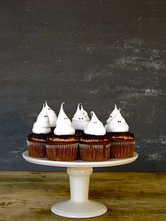 Ghost Meringue Cupcakes with Oreo Dirt by jennysteffens:   Don't worry about failed attempts at piping meringue. Even 'imperfect' ghosts are just part of the 'scary' crowd. #Ghost_Meringue_Cupcakes #Swiss_Meringue #Halloween_Cupcakes #jennysteffens
