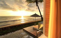 Wonderful Wooden Terrace Floor and White Umbrella with Awesome Sunset Beach View