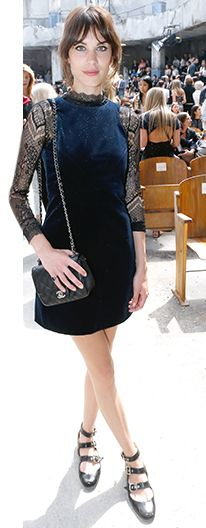 Alexa Chung wearing a mini with strappy shoes and chain-strap bag.