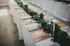 greenery table runner, photo by Caleb John Hill http://ruffledblog.com/downtown-los-angeles-wedding #weddingreception #weddingideas #tablerunner