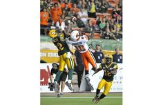 Joe Burnett of the Edmonton Eskimos knocks down a two point conversion attempt intended for Kierrie Johnson of the B.C. Lions at Commonwealth Stadium in Edmonton on Saturday, Sept. 22, 2012.