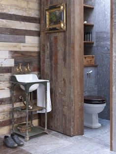 Reclaimed, salvaged wood creates interest in a small bathroom, giving it a rustic appeal.