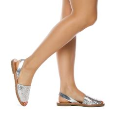 Sparkly silver flat sandals.