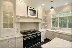 Classic white kitchen with black stove