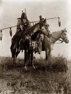 You are viewing an important image of Crow Warriors On Horseback. It was taken in 1908 by Edward S. Curtis.    The picture shows Bird on the Ground and Forked Iron dressed in Traditional Native American style.    We have created this collection of pictures primarily to serve as an easy to access educational tool. Contact curator@old-picture.com.    Image ID# 216B17E7