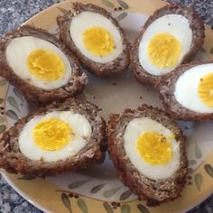 Scotch eggs- hard boiled egg wrapped in breakfast sausage, egg and breadcrumbs then deep fried.