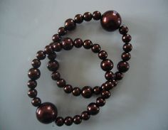 "Motion sickness bracelet set in ""Rich Chocolate"" for stylish motion sickness relief at http://www.queasybeads.com"