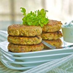 Crispy-tender zucchini cakes with tangy yogurt sauce. Great for vegetarian dinner.
