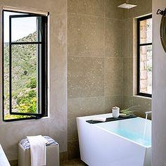 Earthy-meets-sleek bathroom with seagrass limestone