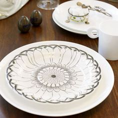 Accent a set of basic white dishes with a few beautiful vintage pieces. The basic dish acts as a white frame to make the patterned piece pop.